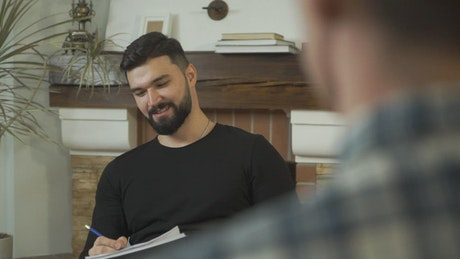 Bearded man telling a story in a meeting