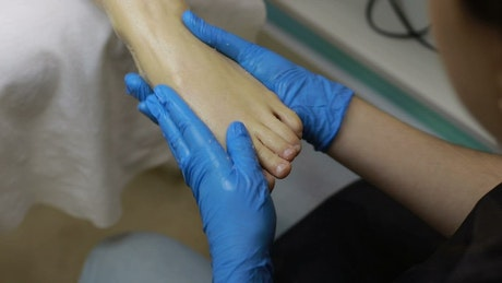 Beautician applying lotion during a spa session