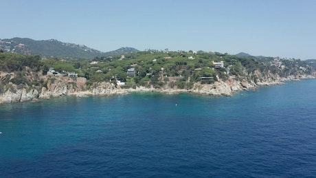 Beautiful blue ocean leading to a rough coastline