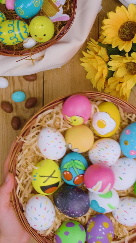 Beautiful easter eggs on a table with flowers