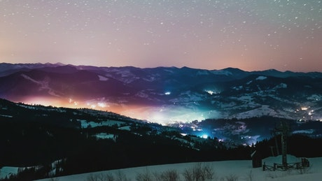 Beautiful night landscape of a town and the stars