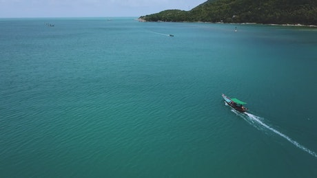 Beautiful peninsula with boats in the water seen from above