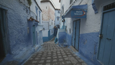 Beautiful street with blue facades in Morocco