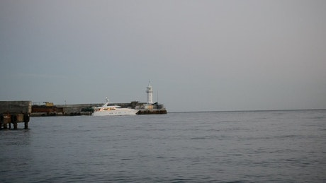 Beautiful white boat leaving port