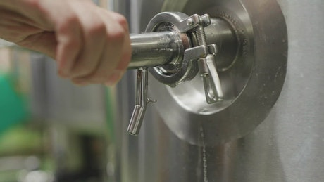 Beer being served from a brewer tank
