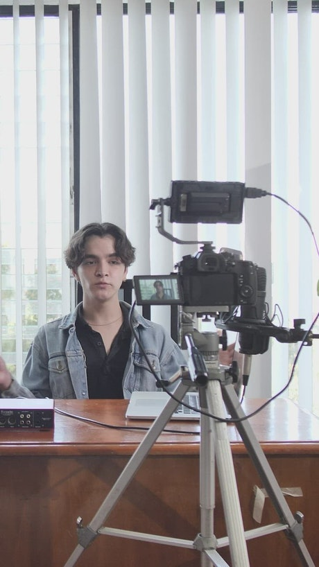 Behind the scenes of a speaker talking on camera