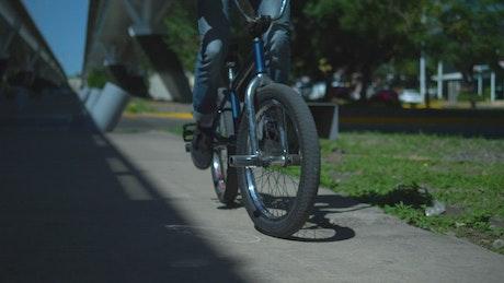 Bicycle being used on the sidewalk