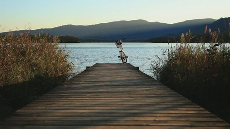 Bicycle on a pier next to a river