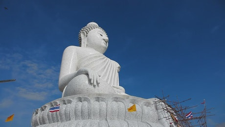 Big Buddha monument with flags