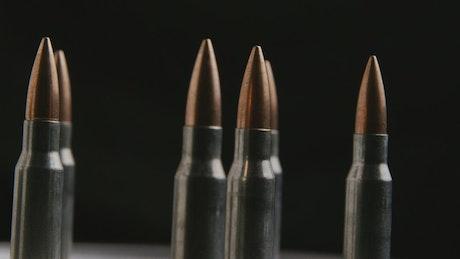 Big bullets rotating on a black background