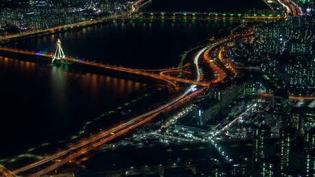 Big river surrounded by a big city at night