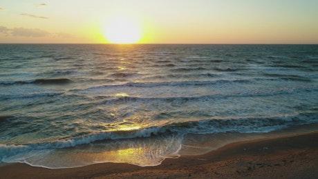 Big sun on the beach and sea skyline