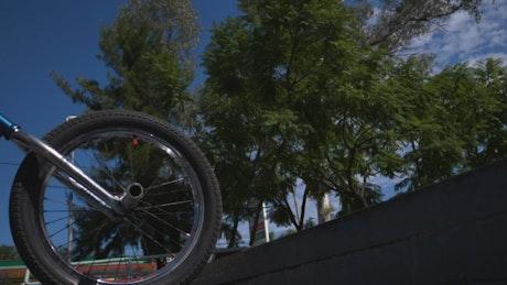 Biker doing BMX tricks
