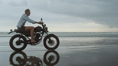 Biker riding on the beach