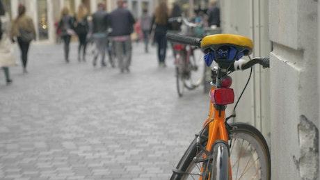 Bikes parked along a street