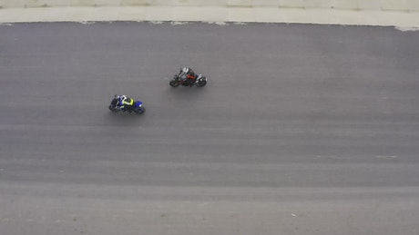 Bikes racing on a dirt track