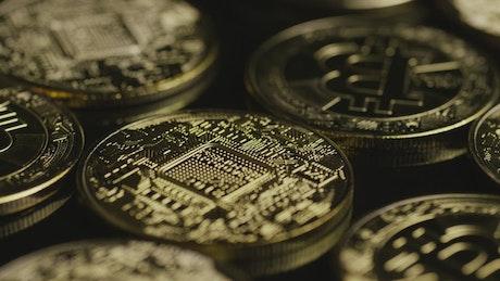 Bitcoins on a black surface