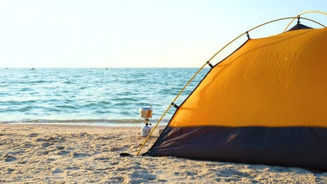 Black and yellow camping tent on the beach