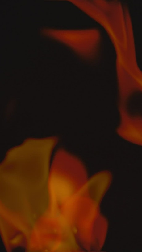 Black background with two flames waving