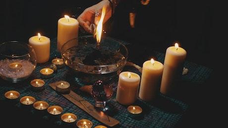 Black magic ritual in a dark room