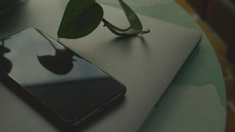 Black phone on laptop