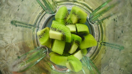 Blending sliced kiwi, top shot