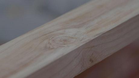 Block of wood being measured
