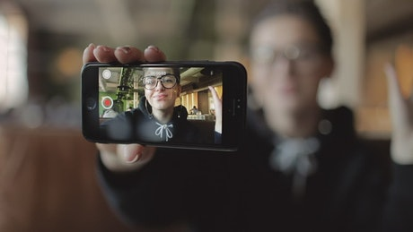 Blogger recording himself with his cell phone