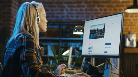 Blonde girl surfing the Internet at the office