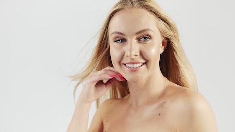 Blonde skincare model on white background