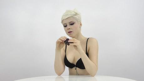 Blonde woman eating chocolate