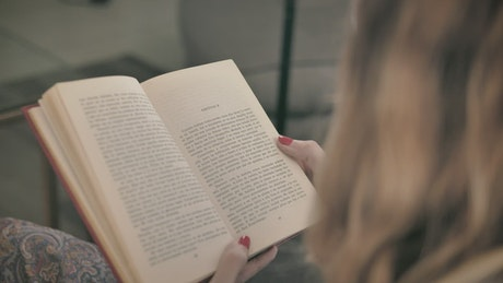Blonde woman reading a book