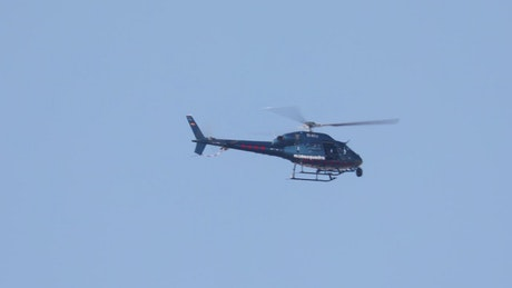Blue helicopter flying
