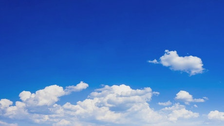 Blue sky with clouds moving and disappearing