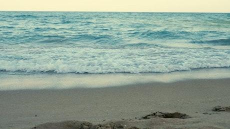 Blue waves breaking by footprints