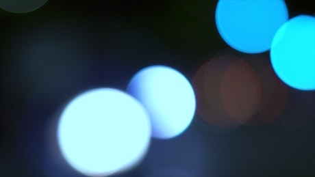 Blurred abstract cars lights at night with bokeh effect