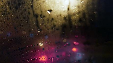 Blurred car lights through the rain