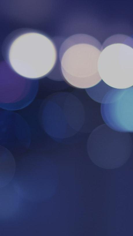 Blurred circular lights on blue