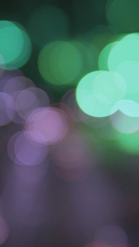 Blurred green and purple lights bokeh