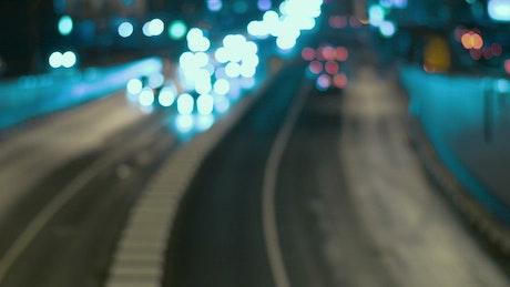 Blurred traffic heading towards the camera