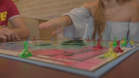 Board game with people around playing