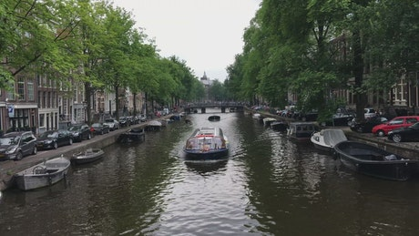 Boat crossing the canal in Amsterdam