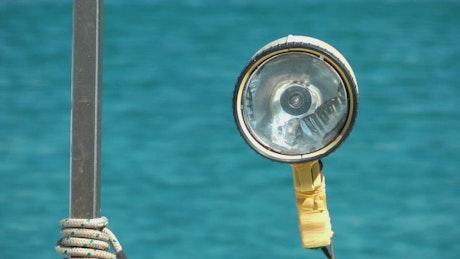 Boat lamp sailing in the sea