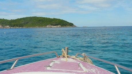Boat sailing near an island