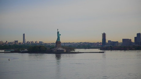 Boat sailing past the Statue of Liberty