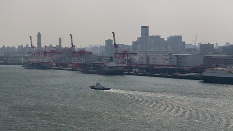 Boat traffic in the river by the Tokio port