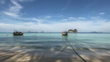 Boats floating at the tropical seashore