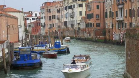Boats heading through Venice