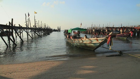 Boats on the shore of a beach in Indonesia