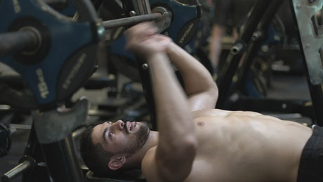 Bodybuilder doing chest exercises in the gym